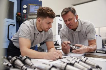 man teaching precision engineering
